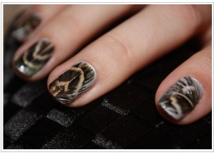Intricate Bird Feather Nail Art
