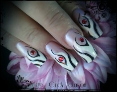 Zebra and Eye Gem Nail Design
